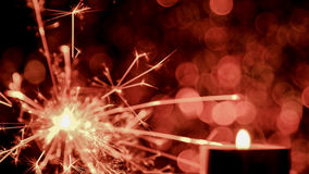 Blur image style. Christmas and New Year party sparkler and Candle flame light Stock Photos