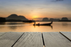 Blur image of terrace wood and beautiful seascape. Defocused and blur image of terrace wood and beautiful seascape and fisherman in morning view for background Stock Photography