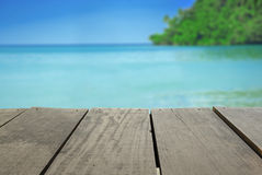 Blur image of terrace wood and beautiful seascape. Defocused and blur image of terrace wood and beautiful seascape and sunset view for background usage Stock Images