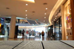 Blur image of terrace wood and Beautiful shopping mall Royalty Free Stock Images