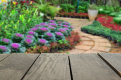 Blur image of terrace wood and beautiful walkway park. Defocused and blur image of terrace wood and beautiful walkway park for background usage Royalty Free Stock Photo