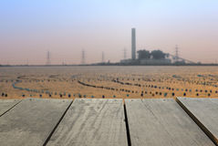 Blur image of terrace wood and Coal-Fired Power Plant. Defocused and blur image of terrace wood and Coal-Fired Power Plant industrial view for background usage Stock Image