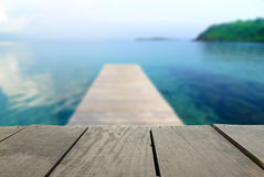Blur image of terrace wood and Jetty walkway into sea. Defocused and blur image of terrace wood and Jetty walkway into the sea for background usage Stock Images