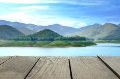 Blur image of terrace wood and scenery view and sky Stock Images