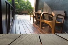 Blur image of terrace wood and Wooden terrace and classic chair Stock Photo