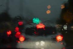 Cars traffic jam on night with rain. Royalty Free Stock Image