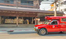 Blur image of Unidentified driver and tourists in red car vehicl Royalty Free Stock Images