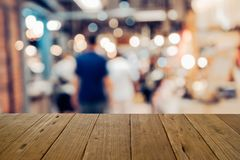 Blur image wood table on shopping mall and people with bokeh. Blur image wood table on shopping mall and people with bokeh Royalty Free Stock Photography