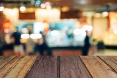 Blur image wood table on shopping mall and people with bokeh. Blur image wood table on shopping mall and people with bokeh Stock Photo