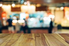 Blur image wood table on shopping mall and people with bokeh. Blur image wood table on shopping mall and people with bokeh Royalty Free Stock Photos