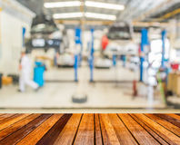 Blur image of worker fixing car in ther garage. Stock Image