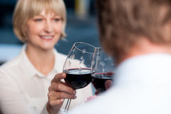 Blur images of couple raises a glass of red wine Stock Photos