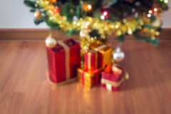 Blur light celebration on christmas tree with gift box Stock Images