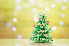 Blur light celebration on christmas tree with wall background Royalty Free Stock Photo