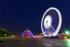 Blur light of Ferris wheel in night time. Blur light of Ferris wheel moving in night time Stock Photo