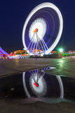 Blur light of Ferris wheel in night time. Blur light of Ferris wheel moving in night time Royalty Free Stock Images