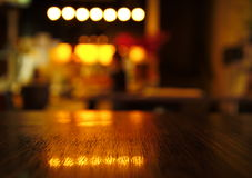 Blur light reflection on table in bar at night b. Ackground Royalty Free Stock Images