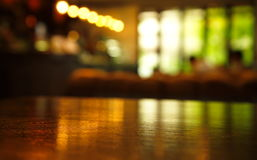 Blur light reflection on table in bar at night. Background Royalty Free Stock Images