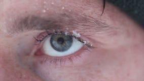 Blur man Eye with snowflake closeup stock video footage