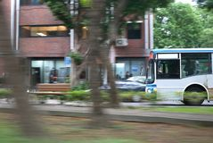 Blur motion of bus driving on road during rush hour Stock Image