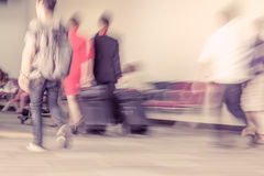 Blur motion of passengers walking at airport Stock Image