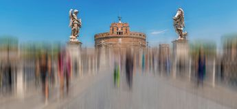 Blur motion with statues of angels in front of castle Sant Angel. Panoramic view with Angel`s Bridge and Statues of Angels by sculptor Ercole Ferrata, in front Stock Photo