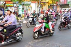 Blur of motorbike traffic Stock Photos