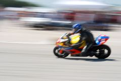 Blur motorcycle. Motorcycle races,  motorcycle in full speed,  blur, panning with copy space Stock Photography