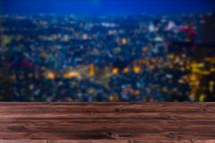 Blur Night city with wood table f stock images