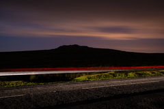 Blur night shoot of fast driving car. With blured clouds and moon royalty free stock photography