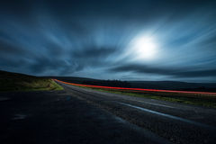 Blur night shoot of fast driving car. With blured clouds and moon stock images