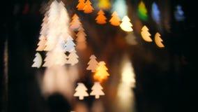 Blur Night Traffic Makes Christmas Tree Shape Bokeh Background. 4K. Blur Night Traffic Makes Christmas Tree Shape Bokeh Background. 4K stock video