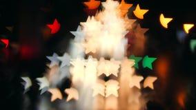 Blur Night Traffic Makes Stars Shape Bokeh Background. 4K. Blur Night Traffic Makes Stars Shape Bokeh Background. 4K stock footage