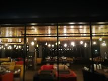 Blur outside restaurant at night in hotel. Blur outside restaurant with warm light at night in hotel Stock Photo