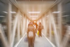 Blur passengers walking in airport terminal ready for travel. Royalty Free Stock Photo