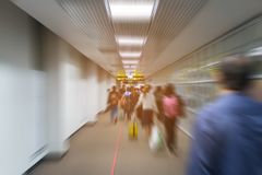 Blur passengers walking in airport terminal ready for travel. Stock Images