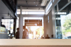 blur people in cafe coffee shop and wood table for display your Royalty Free Stock Images