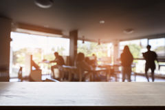 blur people in cafe coffee shop and wood table for display your Royalty Free Stock Image