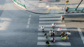 Blur people are moving across the pedestrian crosswalk Royalty Free Stock Image