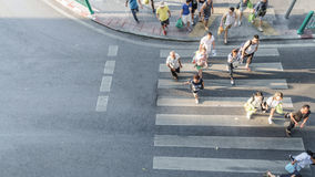 Blur people are moving across the pedestrian crosswalk. In the city road (on top view Royalty Free Stock Photos