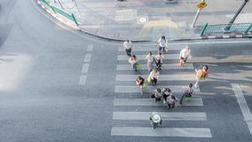 Blur people are moving across the pedestrian crosswalk Royalty Free Stock Images