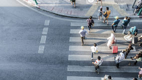 Blur people are moving across the pedestrian crosswalk. In the city road (on top view Royalty Free Stock Image