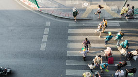 Blur people are moving across the pedestrian crosswalk Royalty Free Stock Photo