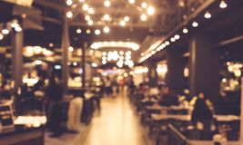 Blur of people in night cafe with lighting Stock Images