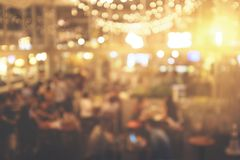 Blur people in restaurant. abstract bokeh in night party for background. Warm effect style picture royalty free stock image
