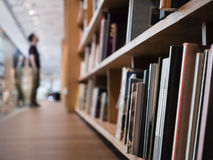 Blur People stand Book shelf in Public Library Stock Photography