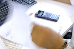 Blur photo of a man at desk Stock Images