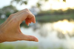 Blur photo of one hand show half of heart. Missing you concept stock image
