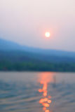 Blur photo of sunset over  lake in Chiang Mai, Thailand Stock Photo