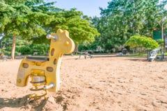 ฺBlur,Playground Spring yellow giraffe Ride. Blur,Playground Spring yellow giraffe Ride Stock Image